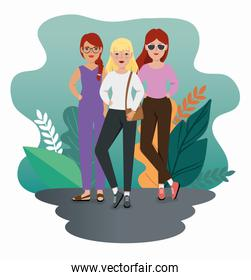 group of beautiful women standing with leafs tropicals