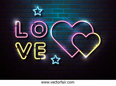 lettering of love with hearts of neon lights in wall