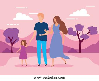 parents with daughter in the park