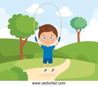 cute boy in park with jumping rope