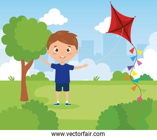 cute boy in park with kite