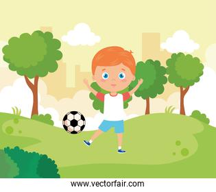 cute boy in park with soccer ball