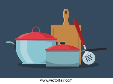 kitchen pots with chopping board and skimmer
