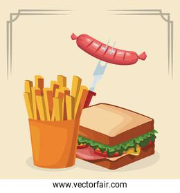 sandwich with french fries and fork with sausage