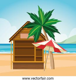 log cabin and parasol at the beach