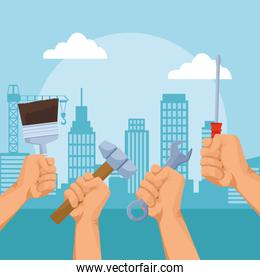 hands with repair tools over urban city buildings background