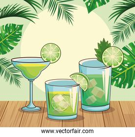 green cocktails over tropical leaves and retro style background