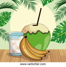 coconut drink and bananas over tropical leaves and retro style background