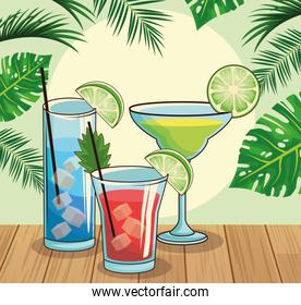 tropical cocktails over tropical leaves and retro style background