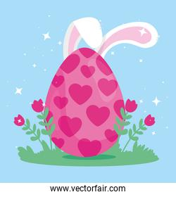 pink egg easter with ears of rabbit and flowers decoration