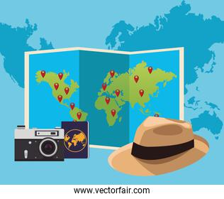 world map and hat with camera and passport