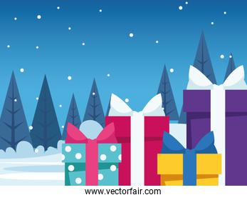 colorful gift boxes over snowy night background