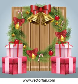 christmas wreath with ornaments and gift boxes over gray background