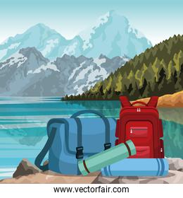 travel backpacks over beautiful lake and mountains landscape background