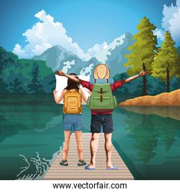 Beautiful lake and mountains landscape with traveler woman and man standing