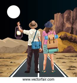 traveler couple with bags and beautiful night western landscape