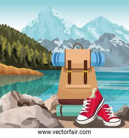 Lake and mountains landscape with travel backpack and casual red shoes