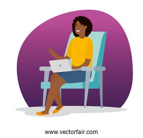 woman afro working at home with laptop sitting in chair