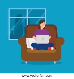 woman working at home with laptop sitting in couch