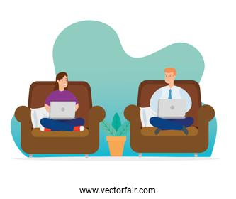 couple working at home with laptops sitting in couch