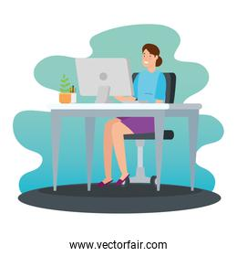 woman working at home with computer in desk