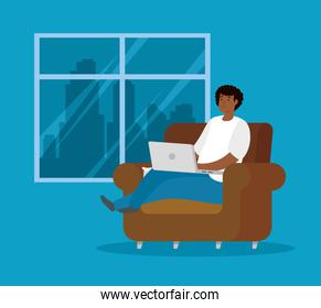man afro working at home with laptop sitting in couch