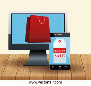 Computer with shopping bag and smartphone with sale tag