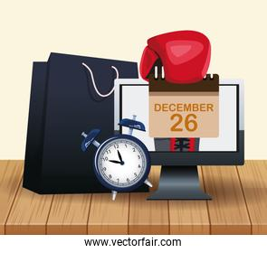 Alarm clock, computer and shopping bag over wooden and white background