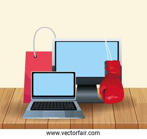 Laptop computers with boxing glove and shopping bag