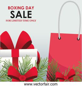 Boxing sale colorful design with decorative pine branches, shopping bag and gift box over gray background