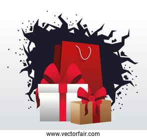 shopping bag and gift boxes over white and black background