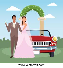 Just married couple standing and classic car over floral arch and landscape background