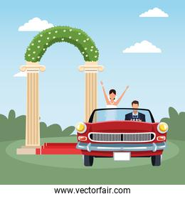 Red classic car with Just married couple over floral arch and landscape background