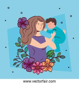 mother lifting baby boy with flowers decoration
