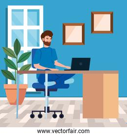 man working in telecommuting with laptop in desk
