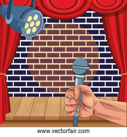 hand with microphone spotlight wall brick stage stand up comedy show