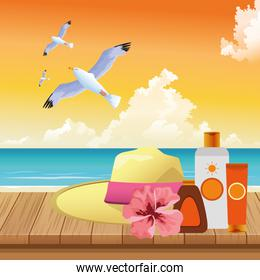 summer time in beach vacations hat sunblocks seagulls on wooden