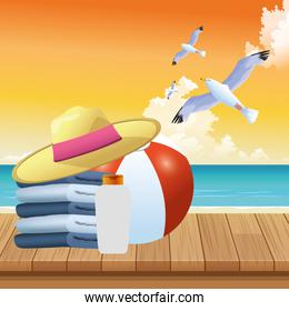 summer time in beach vacations hat ball towels and sunblock