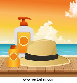 summer time in beach vacations hat bottle skin care sunblock on wooden sea