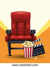 cinema chair with popcorn bucket and clapboard