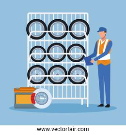 car tires rack and mechanic standing over blue background