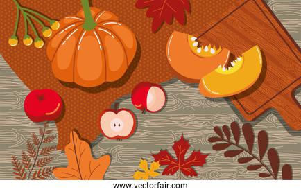 autumn leafs and fruits in wooden background