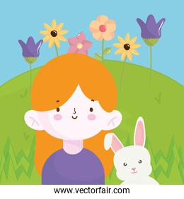 happy little girl with rabbit in the field with flowers