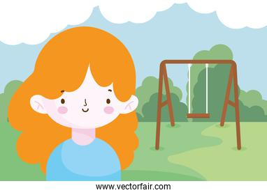 happy little girl in the park with swing