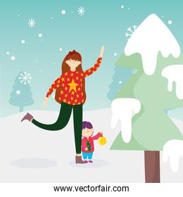 merry christmas mom and son with ball tree snow outdoor celebration