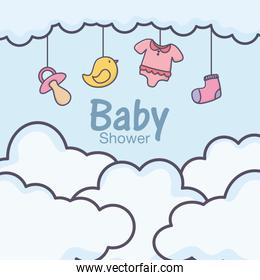 baby shower hanging clothes toys sky clouds