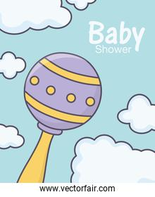 baby shower rattle toy clouds background