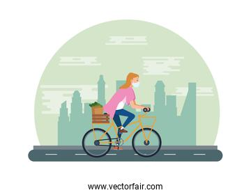 woman using face mask in bicycle transport groceries