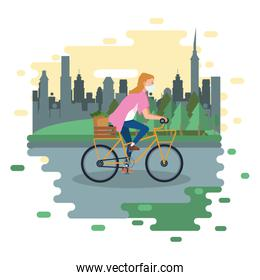 woman using face mask in bicycle with  groceries