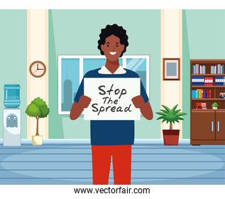 afro man with stop spread covid19 banner